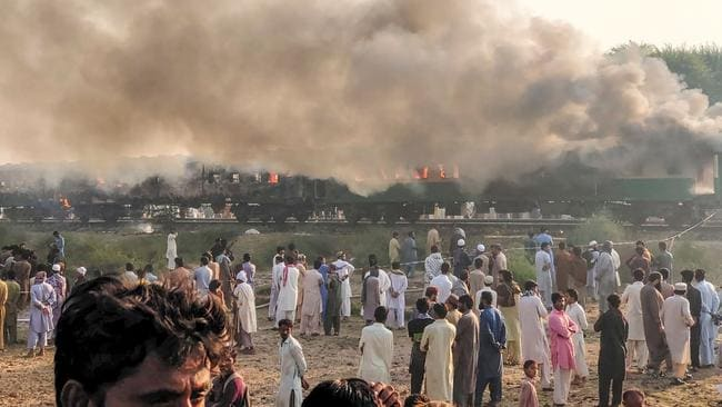 Smoke billows from the train. Picture: Pakistan's Punjab Emergency Service Rescue 1122/AFP