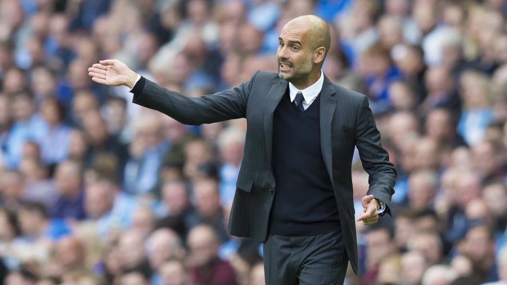 Manchester City s new manager Pep Guardiola issues instructions. 29708abbb30eb