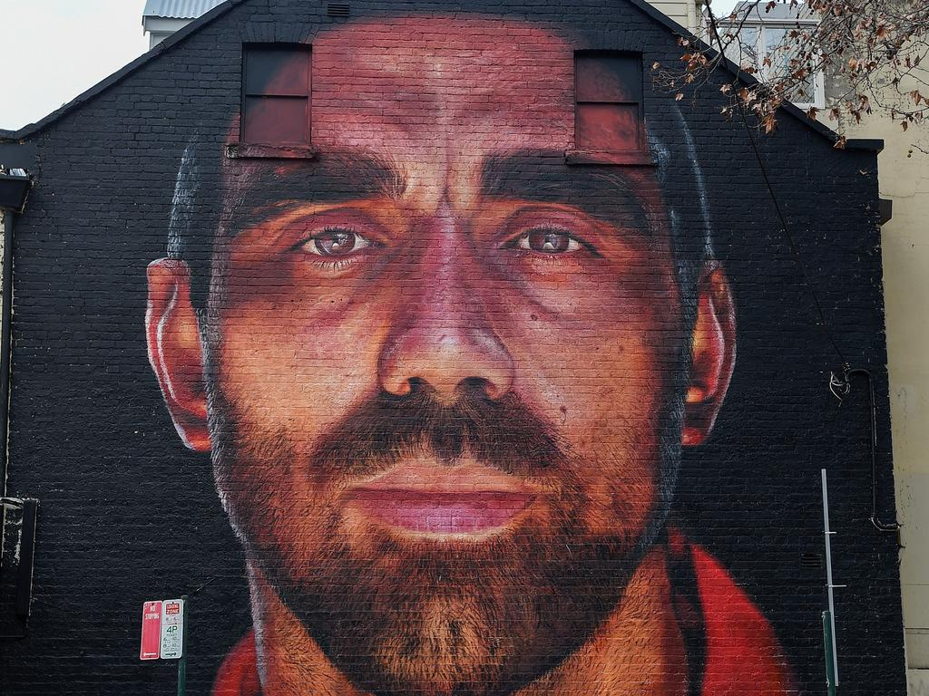 A mural of former AFL player Adam Goodes appeared in Sydney last week. The Australian of the Year and Sydney Swans icon polarised crowds after taking a stand against racism and was effectively booed into retirement. Picture: AAP Image/Bianca De Marchi.