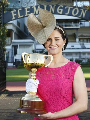 Michelle Payne with the Melbourne Cup trophy at Flemington. Picture: David Caird