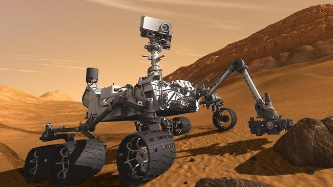 In this 2011 artist's rendering provided by NASA/JPL-Caltech, the Mars Science Laboratory Curiosity rover examines a rock on Mars with a set of tools at the end of its arm, which extends about 2 meters. AP / NASA/JPL-Caltech