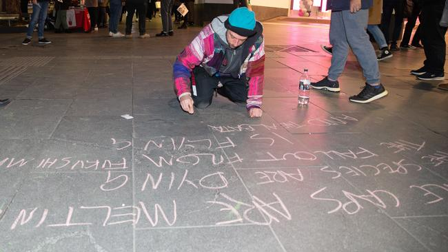 Protesters wrote messages in chalk on Swanton Street and surrounding footpaths. Picture: Sarah Matray