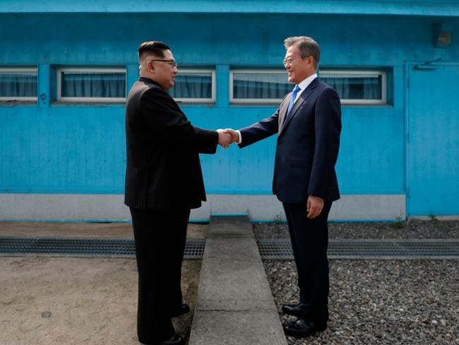 North Korea's leader Kim Jong-un and South Korea's President Moon Jae-in at the Military Demarcation Line before a historic summit on April 27, 2018. Picture: AFP