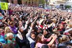 A large crowd of mostly young girls gather at a television station where British boy band One Direction is appearing in Sydney, April 11, 2012. (AP Photo)