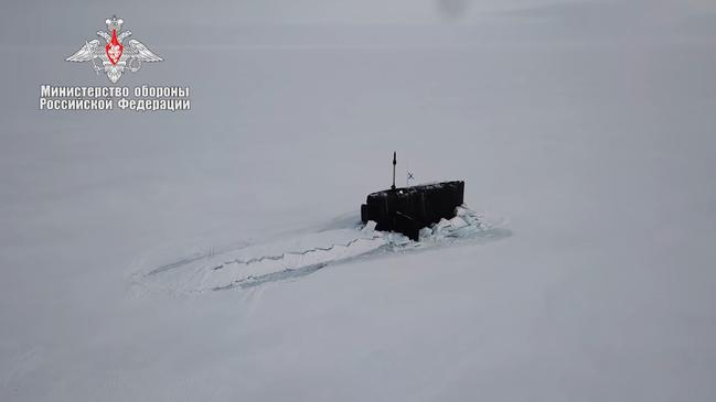 A Russian submarine surfacing in the Arctic