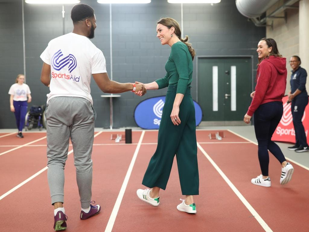 Heptathlete Jessica Ennis-Hill (2nd R) watches as para-athlete sprinter Emmanuel Oyinbo-Coker shakes hands with the Duchess of Cambridge following a short sprint race during a SportsAid Stars event at the London Stadium in Stratford. Picture: Getty