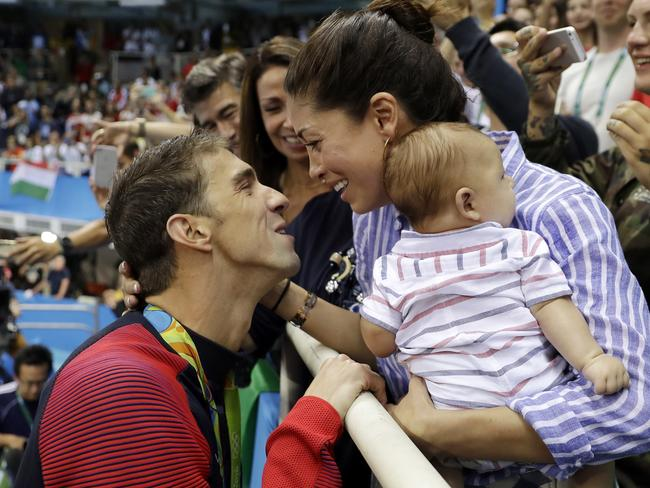 Swimmer Michael Phelps celebrates winning gold at the Rio Olympics with wife, Nicole Johnson, and son, Boomer. Picture: AP Photo/Matt Slocum, File