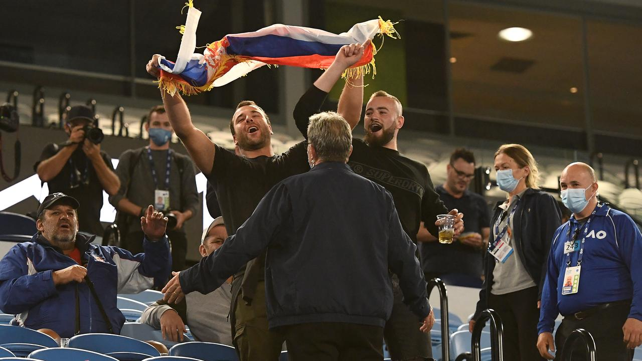 Serbian fans are told to leave at the 11:30pm curfew time. (Photo by Quinn Rooney/Getty Images)