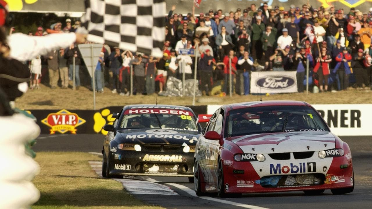 Mark Skaife takes the chequered flag to win the 2002 Bob Jane T-Marts Bathurst 1000.