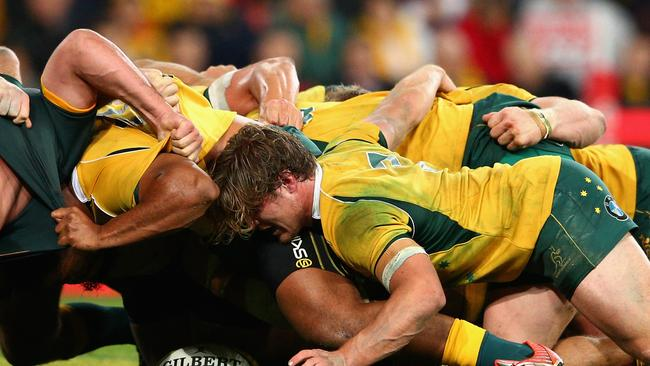 Michael Hooper of the Wallabies and team mates pack down a scrum.
