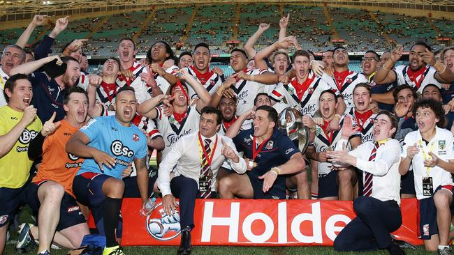 Roosters players celebrate victory after the 2016 Holden Cup U20s Grand Final.