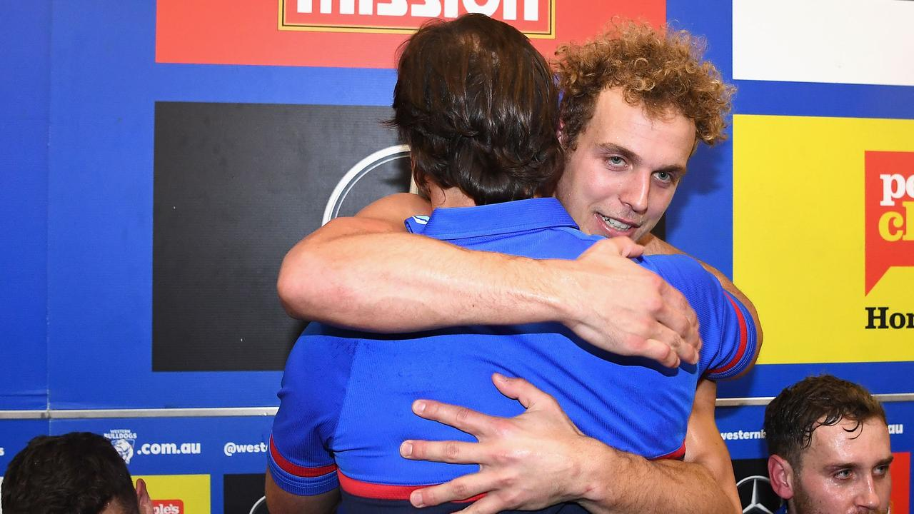 Mitch Wallis and Luke Beveridge hug after their Round 15 win. Photo: Quinn Rooney/Getty Images