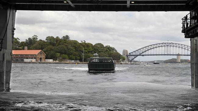 Sea garage ... A landing craft belonging to approaches HMAS Canberra's dock in Sydney Harbour. Source: Defence