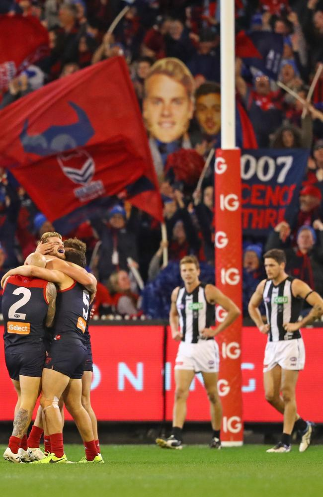 Jack Watts celebrates with teammates after kicking a goal in the final minutes against Collingwood.