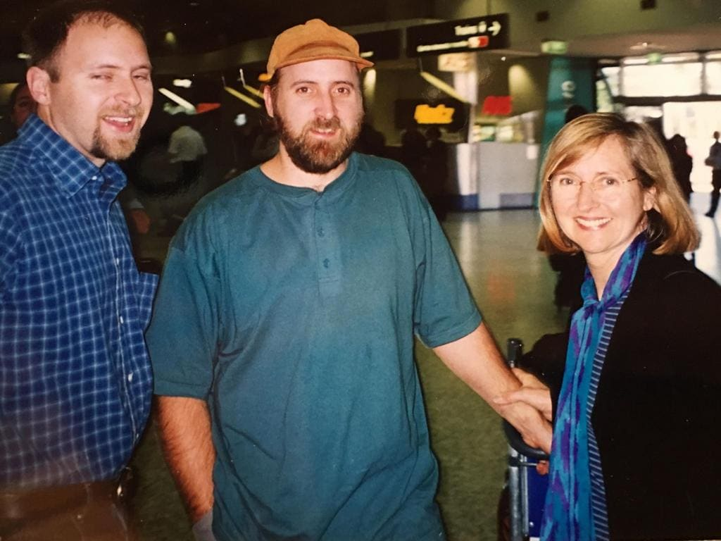Matthew Klein being met at the airport by his mother and brother after leaving the Twelve Tribes. Picture: Supplied