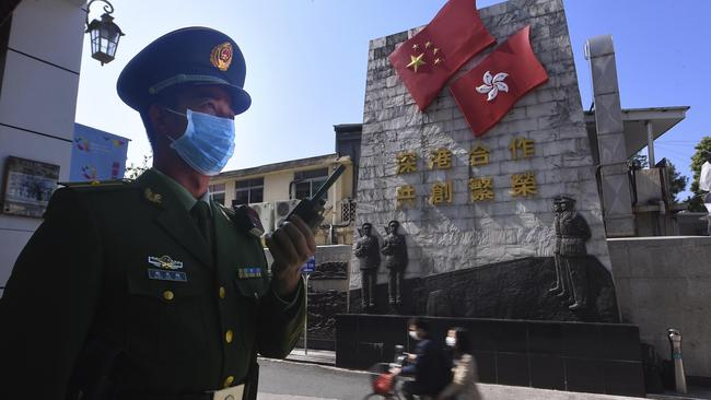 A paramilitary police officer stands guard in an area near the border with Hong Kong in Shenzhen in southern China's Guangdong Province. Picture: AP
