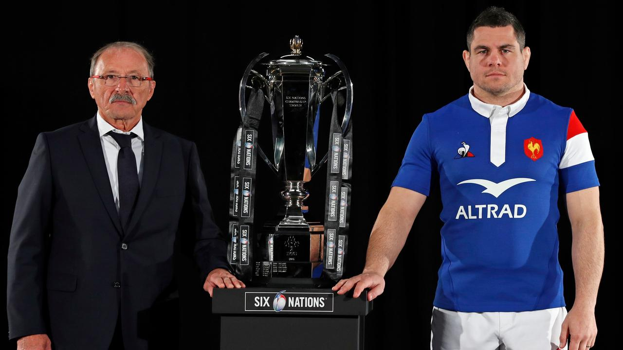 France coach Jacques Brunel and captain Guilhem Guirado pose with the trophy in London.