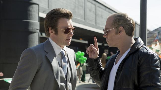 Joel Edgerton and Johnny Depp in a scene from Black Mass.