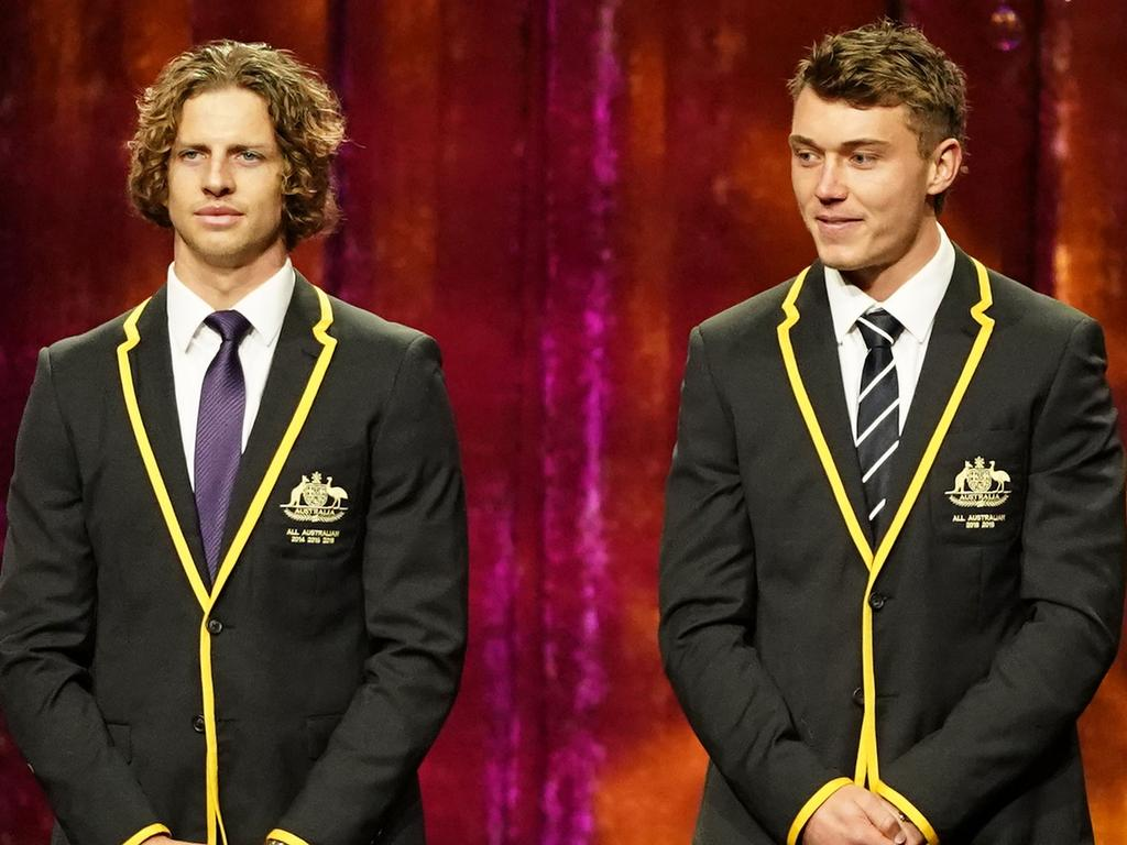 Nat Fyfe of the Dockers, Patrick Cripps of the Blues and Marcus Bontempelli of the Bulldogs are presented during the 2019 Virgin Australia AFL All Australian Awards at the The Palais Theatre in Melbourne, Wednesday, August 28, 2019. The All-Australian team is an all star team of Australian rules footballers, selected by a panel at the end of each season. (AAP Image/Scott Barbour) NO ARCHIVING
