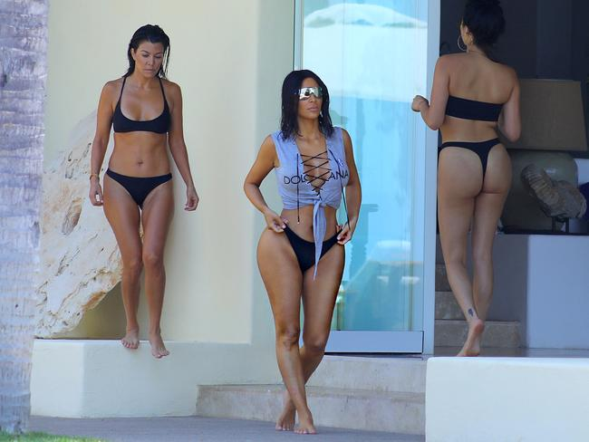 Kim and Kourtney Kardashian have fun in the sun while on vacation with friends at Casa Aramara in Mexico. Picture: Splash