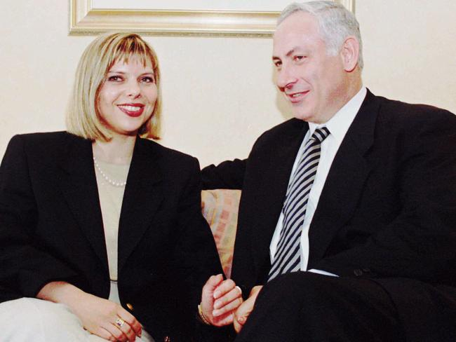 Sara Netanyahu with her husband Benjamin. She has been fined over lavish spending of state funds. Picture: AP Photo