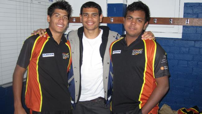 Willie Rioli (right) with cousins Ben (left) and Cyril (middle) at the 2011 Under 18 championships. Picture: Grey Morris