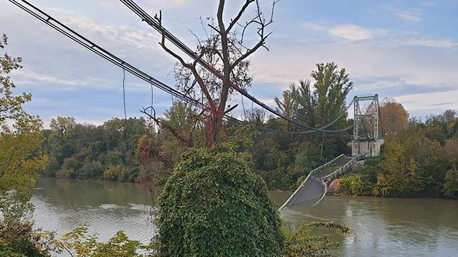 The road suspension bridge linking the towns of Mirepoix-sur-Tarn and Bessieres, after it collapsed with several vehicles into the Tarn river north of the city of Toulouse, in southwest France. Picture: Olivier Le Corre via AP