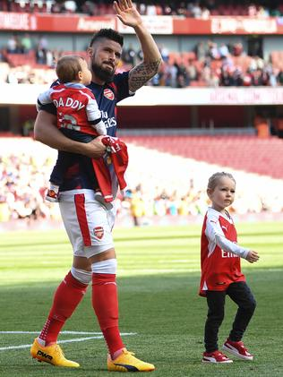 Arsenals French Striker Olivier Giroud Walks On The Pitch With Son Evan And Daughter Jade