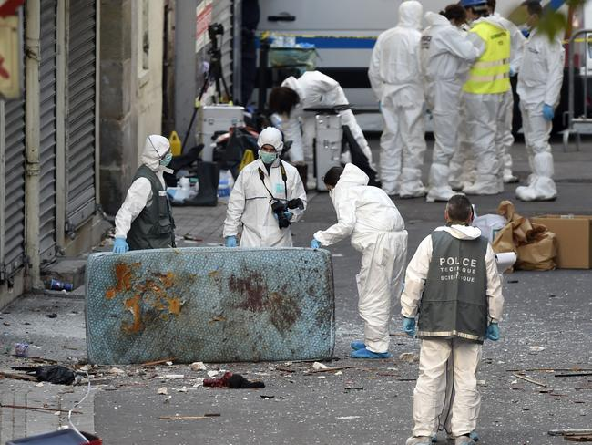 French police in forensic suits search for evidences outside a building in Saint-Denis special forces raided an apartment. Picture: Eric Feferberg/AFP Photo