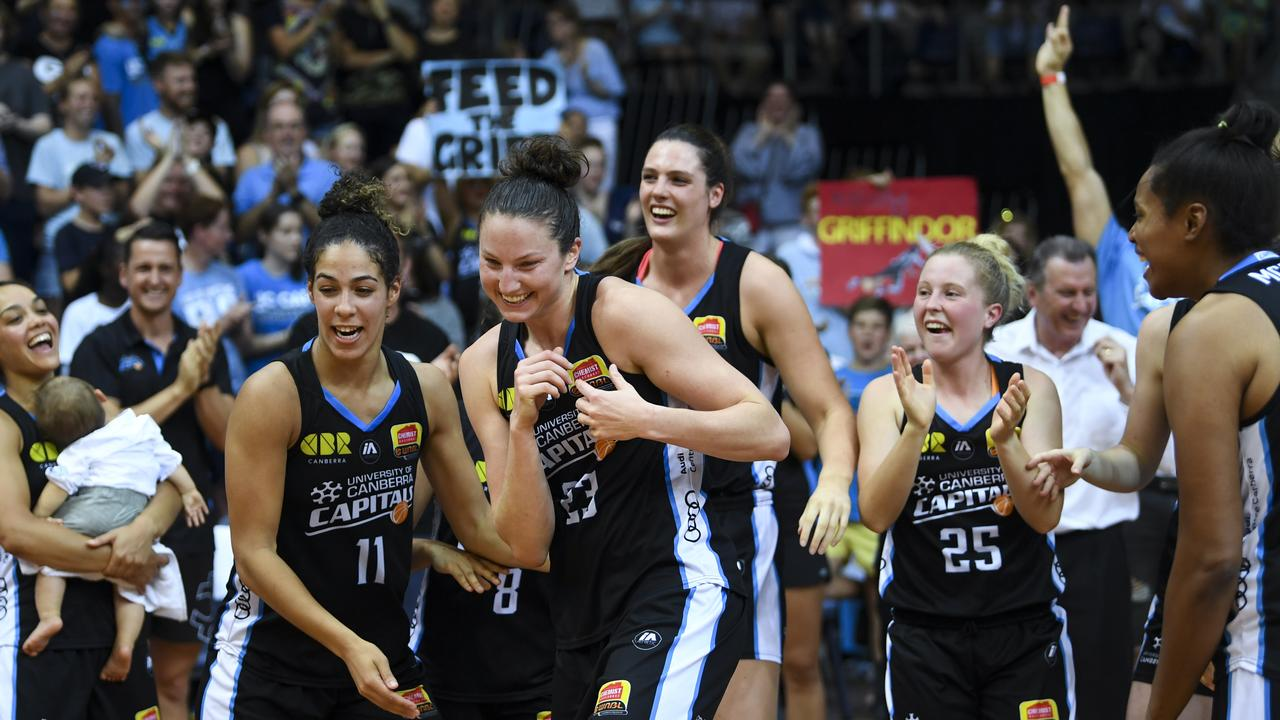 Kelsey Griffin of the Canberra Capitals celebrates with Canberra Capitals players.