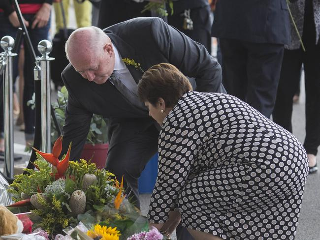 Paying respects ... Governor-general Sir Peter Cosgrove and his wife place a wreath to the victims of MH17 at Schipohl airport, Amsterdam.