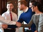Britain's Prince Harry and fiancée Meghan Markle greet performers during a visit to Cardiff Castle in Cardiff, south Wales on January 18, 2018, for a day showcasing the rich culture and heritage of Wales. Picture: AFP