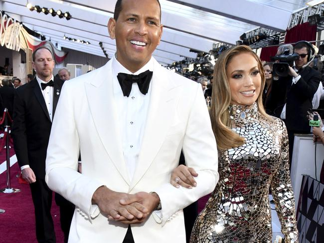 Alex Rodriguez, left, and Jennifer Lopez. In 2017 ARod admitted to using steroids. fellow steroid user Jose Canseco has accused him of cheating on JLo. Picture: Invision/AP