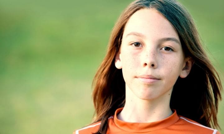 Young Teen Boy with Freckles and Long Hair