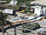 Emergency personnel respond to a collapsed pedestrian bridge at Florida International University on Thursday, March 15, 2018, in the Miami area. The brand-new pedestrian bridge collapsed onto a highway crushing several vehicles. Picture: Roberto Koltun/Miami Herald via AP