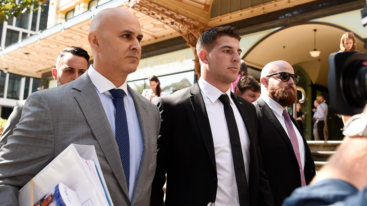 Lawyer Danny Eid (left) and NRL player Curtis Scott (centre) leave the Downing Centre Local Court in Sydney