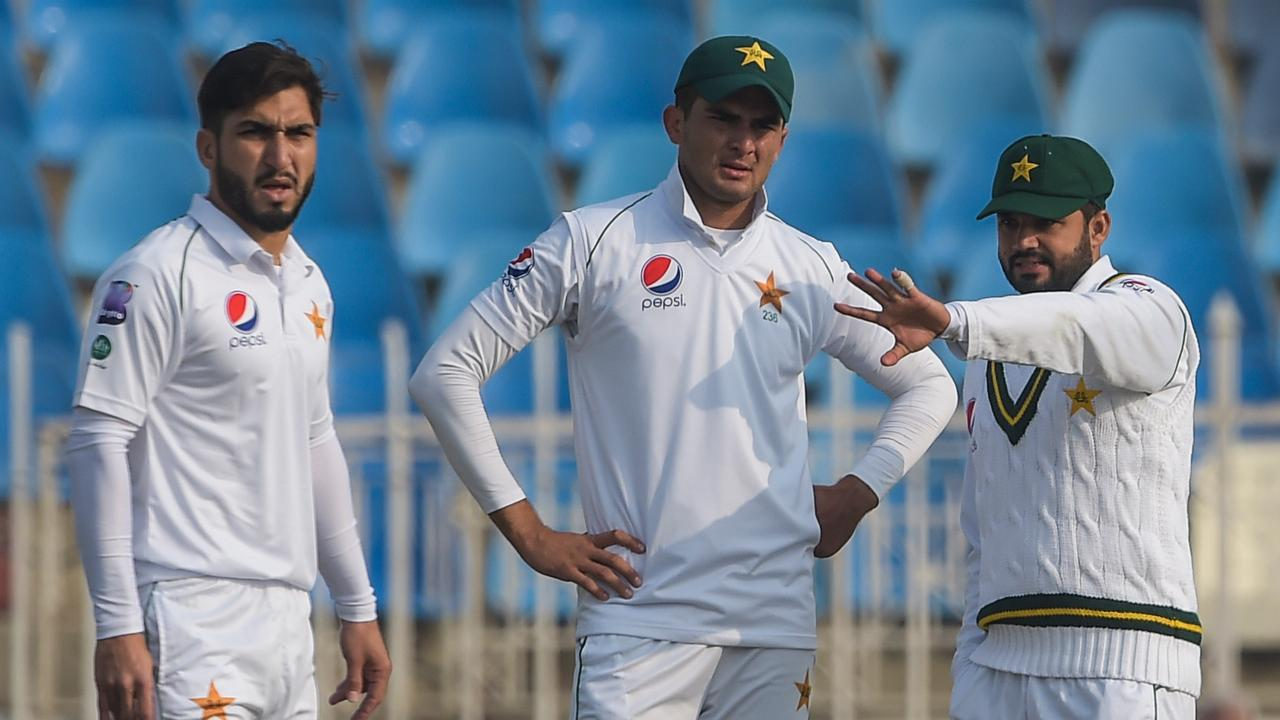 Pakistan's captain Azhar Ali talks tactics with teammates Shaheen Shah and Usman Shinwari.