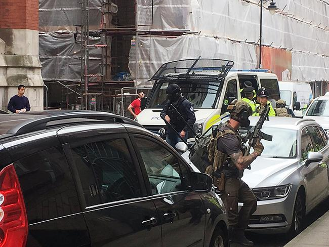 Armed police swoop on Granby House in Manchester. This picture was taken by Louise Bolotin, a freelance journalist who was first on the scene. Picture: @louisebolotin