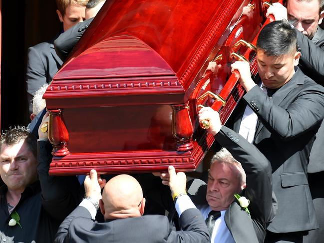 Karen Ristevski's brother Stephen Williams (left) and husband Borce (front right) carry her coffin from St John's Uniting Church in Essendon after her funeral service. Picture: Picture: Nicole Garmston