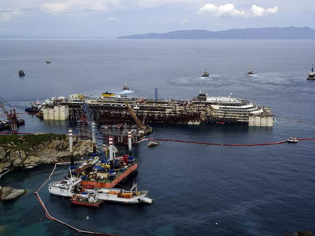 Rising from the deep ... Operations to refloat and tow away the luxury cruise ship Costa Concordia get underway on the tiny Tuscan island of Giglio, Italy. Picture: AP